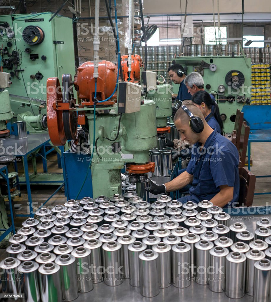 Workers working at a metal factory stock photo