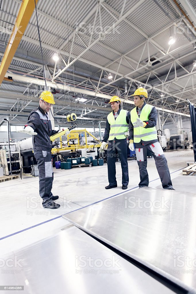 Workers working with aluminium billets stock photo