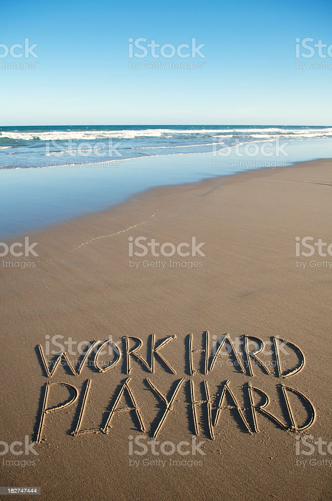 Work-Hard Play-Hard Inspiration Message in Sand stock photo