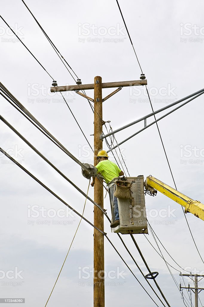workin on the power lines royalty-free stock photo
