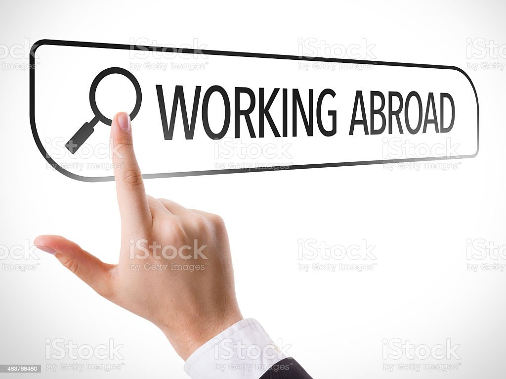 Working Abroad written in search bar on virtual screen stock photo