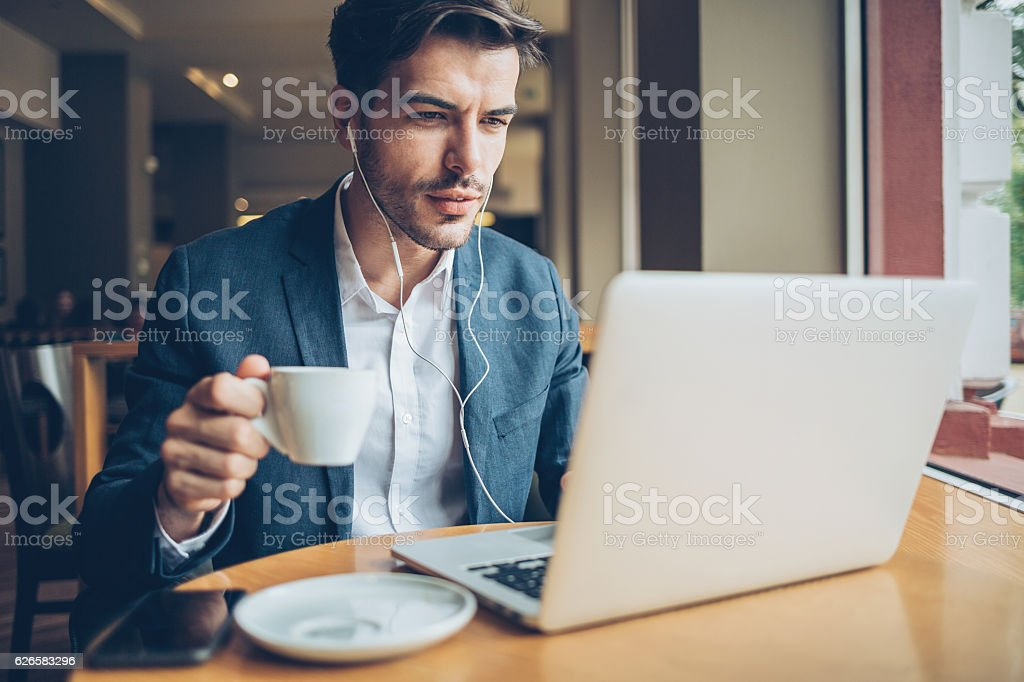 Working and drinking coffee stock photo