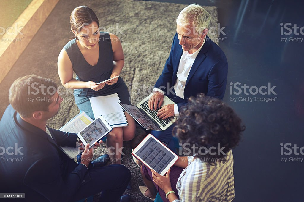 Working as a team helps to build a successful business stock photo
