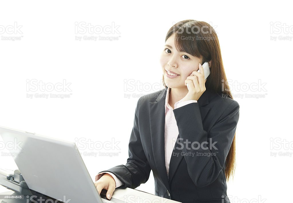 Working Asian business woman stock photo
