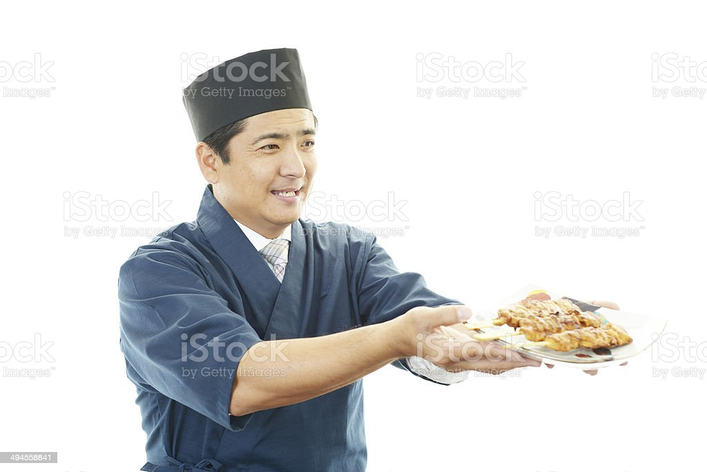 Working Asian cook stock photo