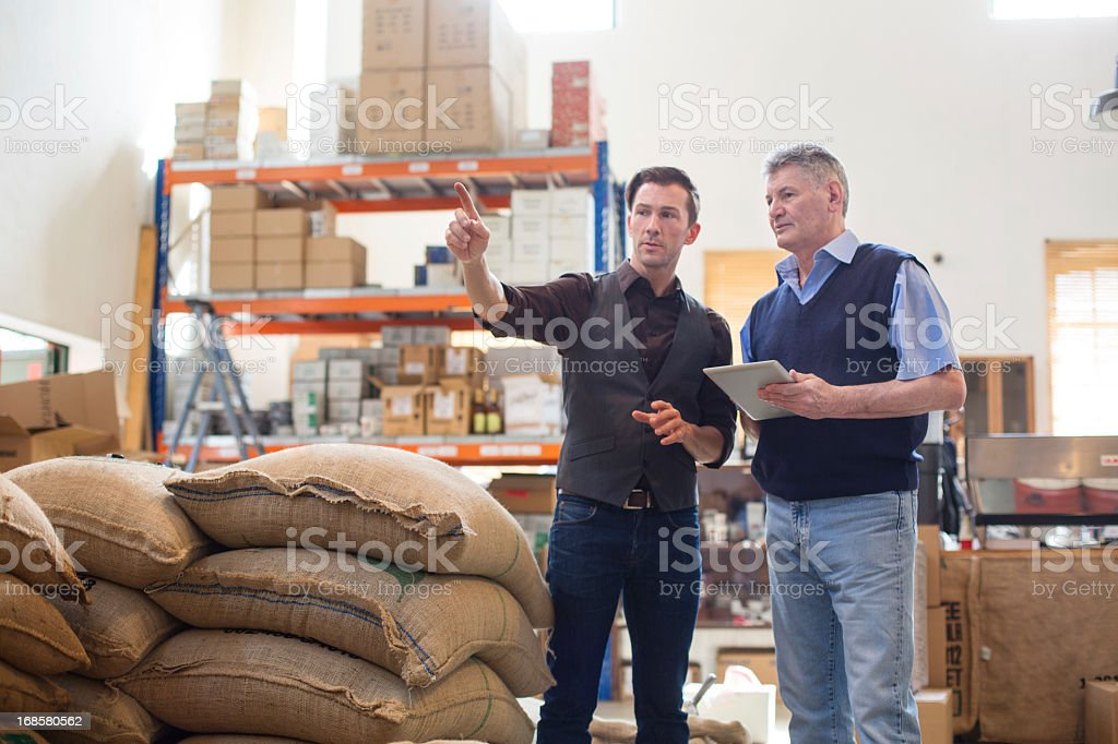 Working at a coffee storage room royalty-free stock photo