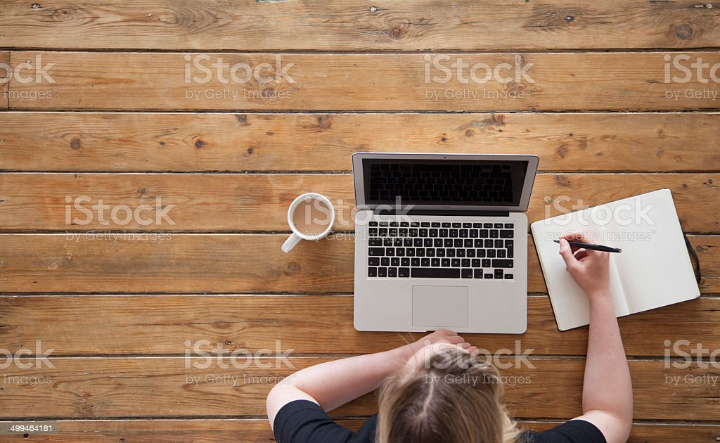 working at a laptop from above stock photo