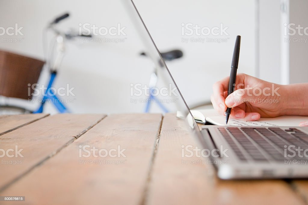 working at a laptop royalty-free stock photo