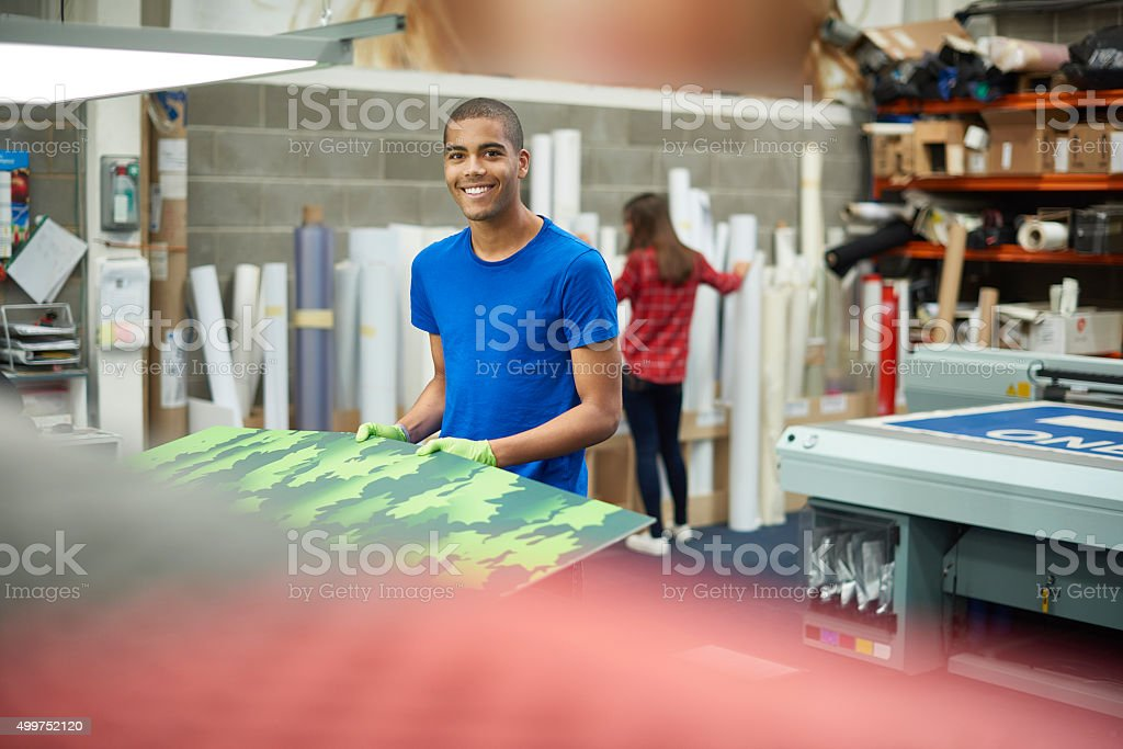 working at a signage company stock photo