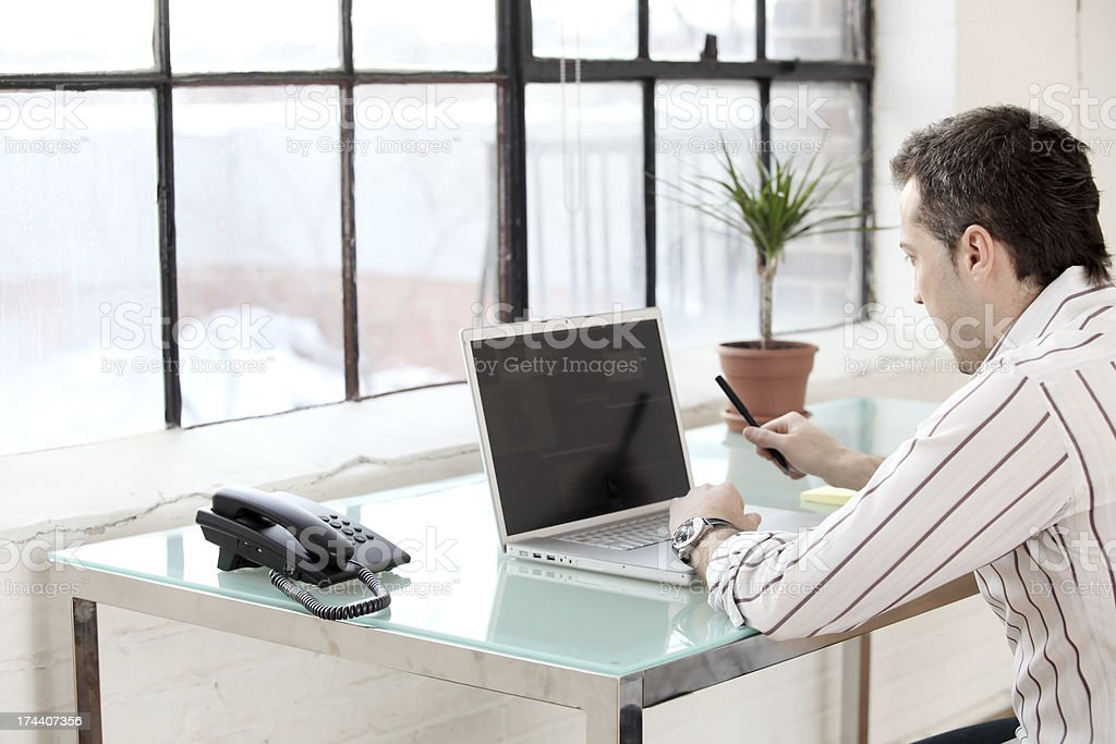 Working at Desk royalty-free stock photo