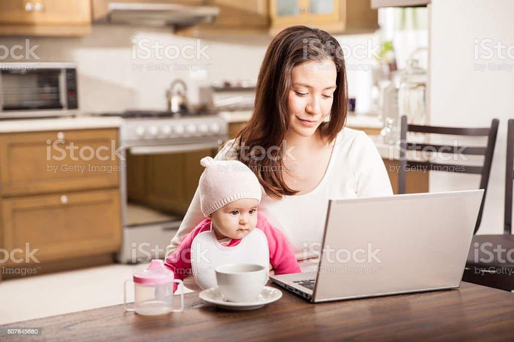Working at home with a baby stock photo