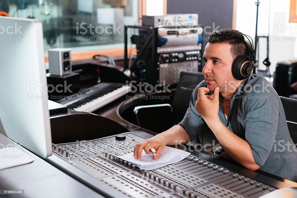 Working at mixing panel stock photo