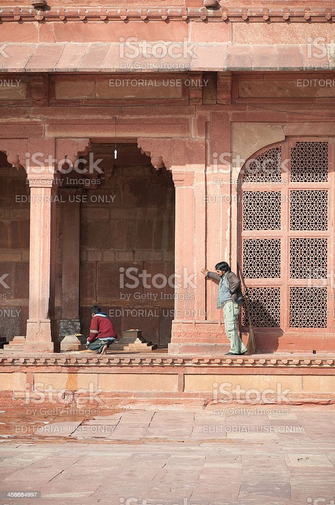Working at mosque in Fatehpur Sikri, India stock photo