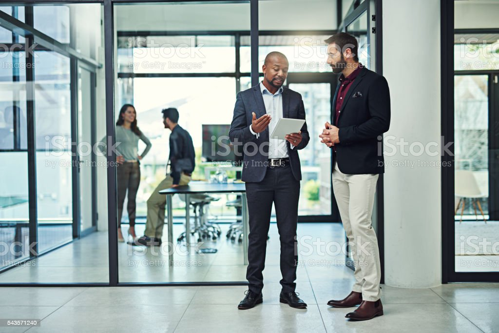Working beyond the boundaries of a desk stock photo