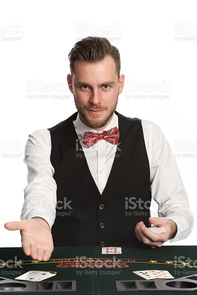 Working black jack dealer in a vest stock photo