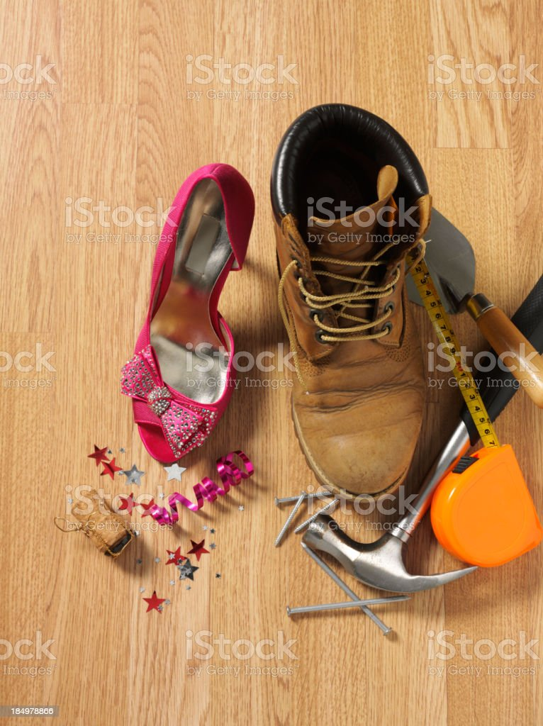 Working Boot and Pink Party Shoe stock photo