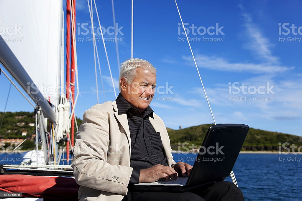 Working Busineseman on the sailboat. royalty-free stock photo