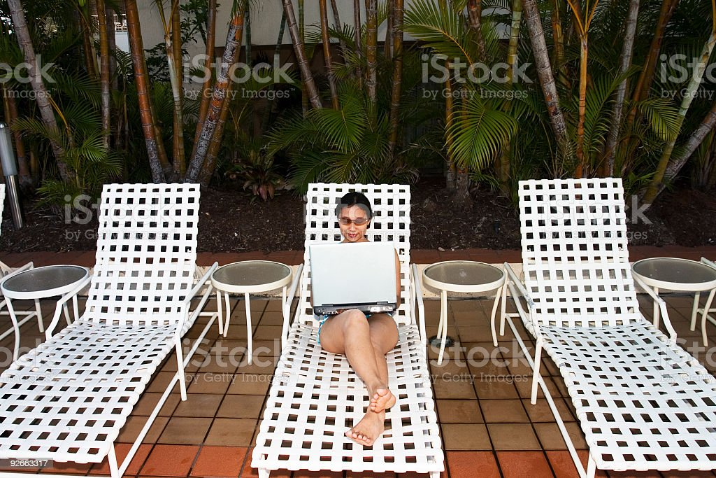 Working by the swimming pool royalty-free stock photo