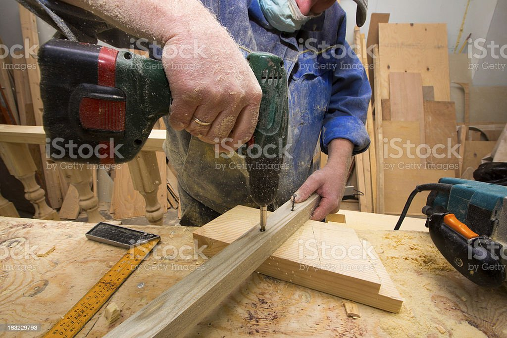 working carpenter with drill. royalty-free stock photo