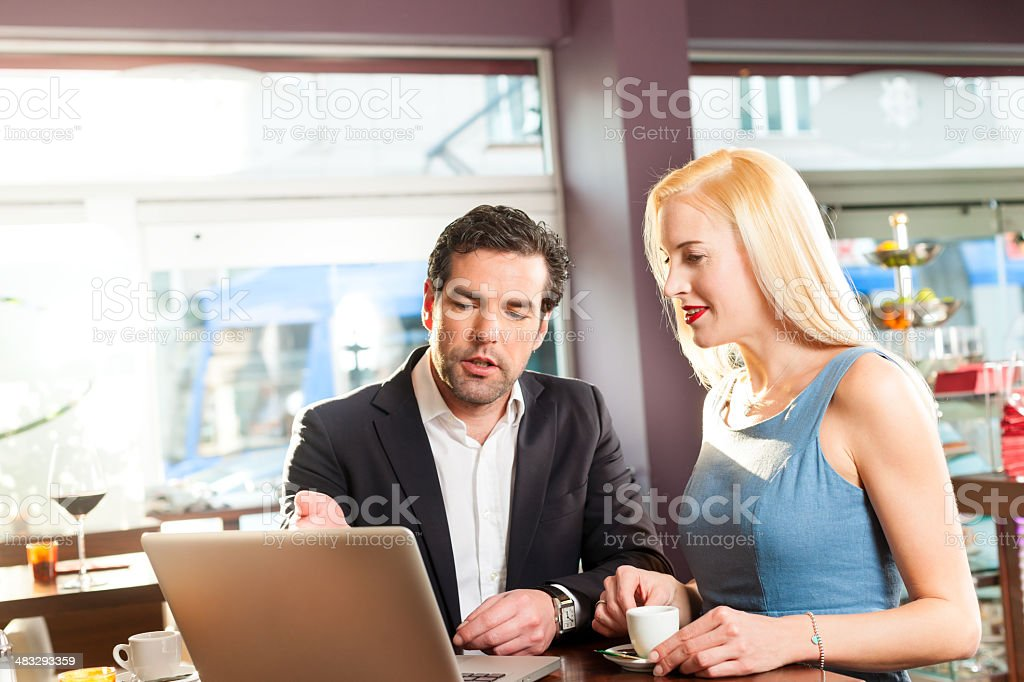 Working colleagues man and woman sitting in cafe royalty-free stock photo