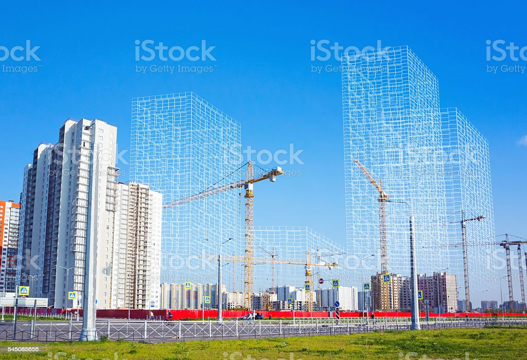 Working cranes and wire-frame structures stock photo