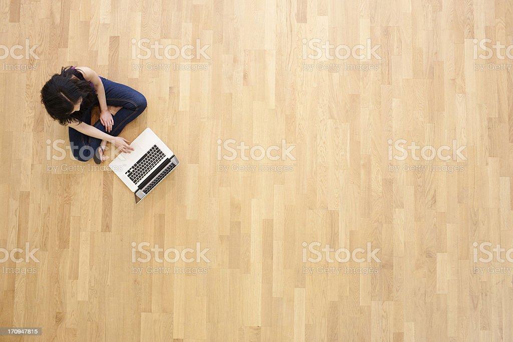 Working cross-legged royalty-free stock photo