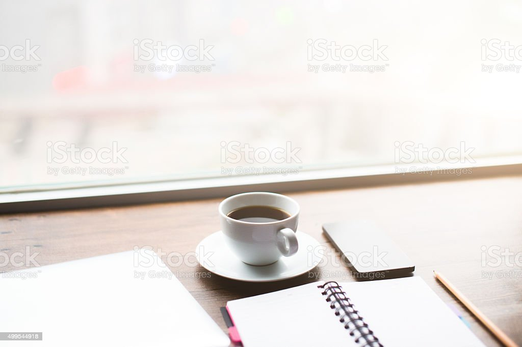 Working desk with laptop,notebook and coffee stock photo