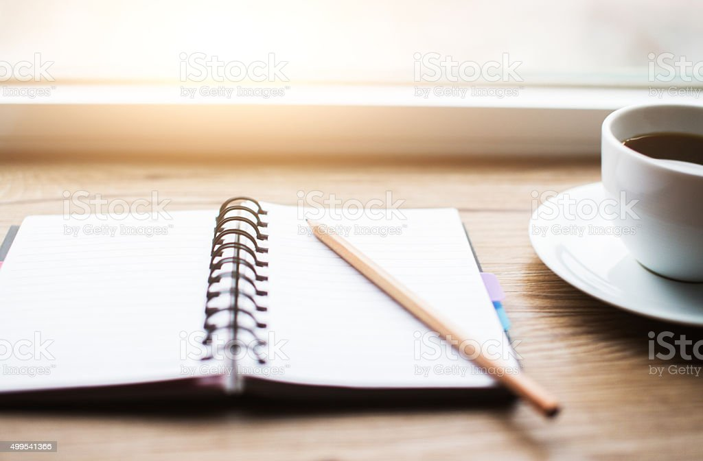 Working desk with notebook and coffee stock photo