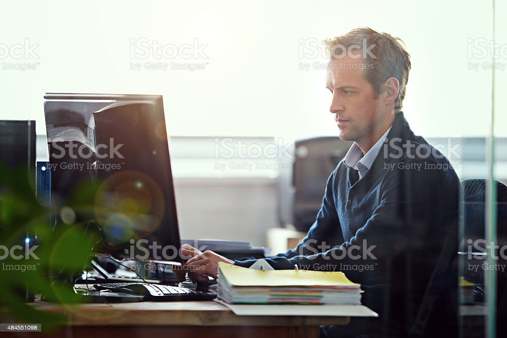 Working diligently stock photo