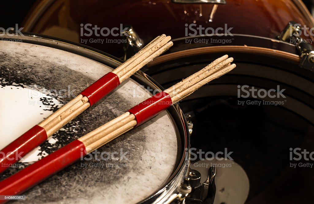 working drum with  sticks, musical instrument stock photo