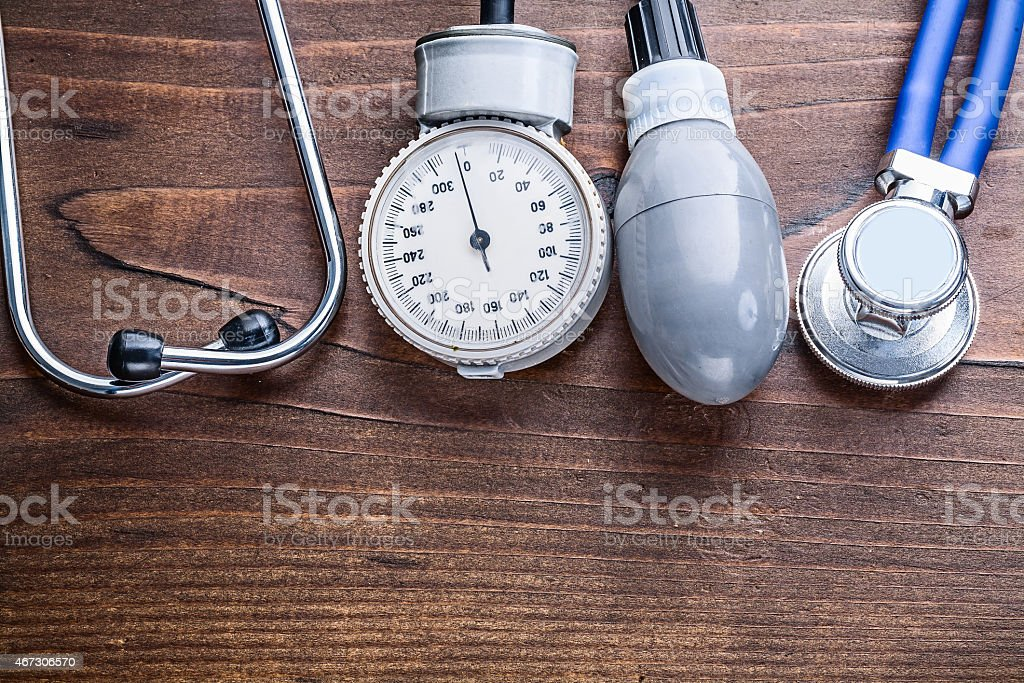 working elements of blood pressure monitor and stethoscope  on v stock photo
