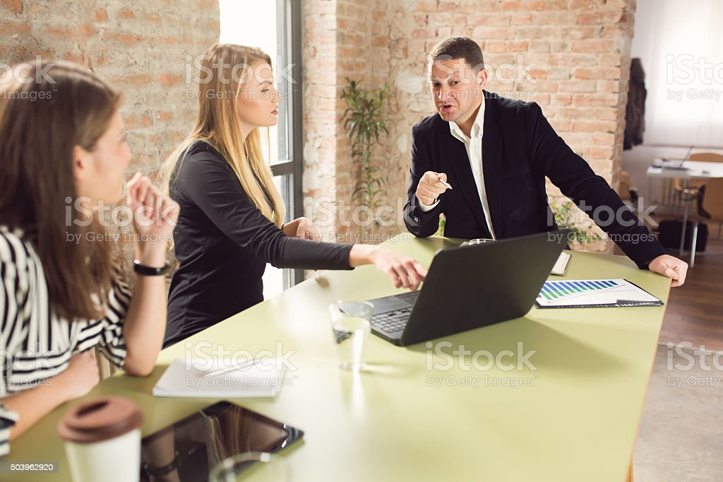 Working For A Hypercritical Boss stock photo