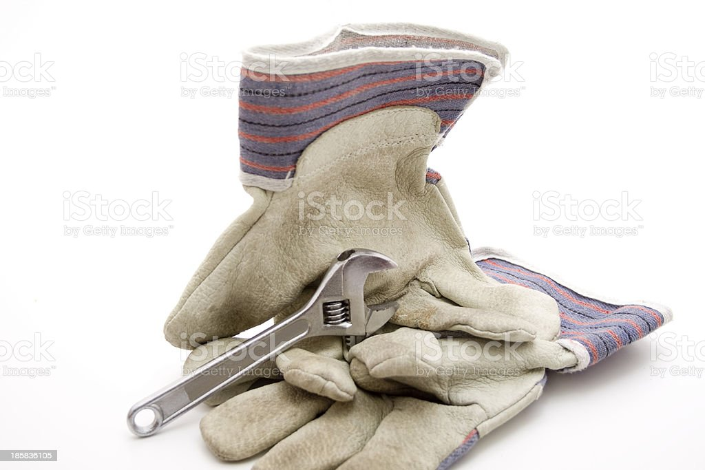 Working gloves with wrench royalty-free stock photo