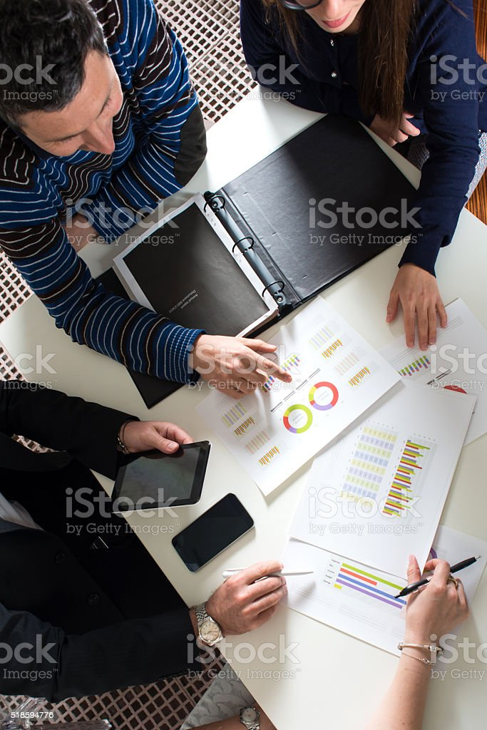 Working Group analyzing Reports stock photo