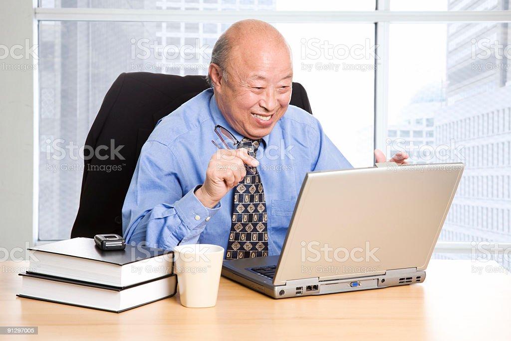 Working happy senior asian businessman stock photo