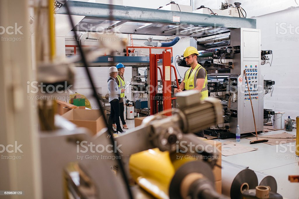 Working hard in production company stock photo
