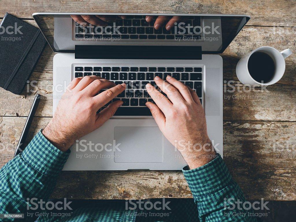 Working Hard On Laptop stock photo