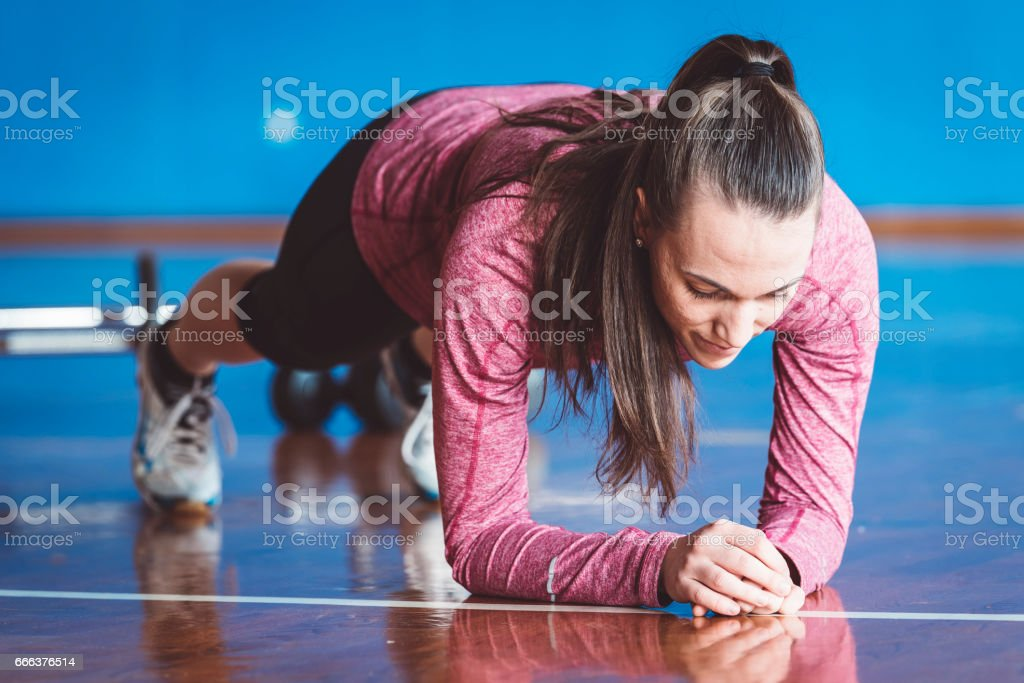 Working her core muscles to the max in the plank stock photo