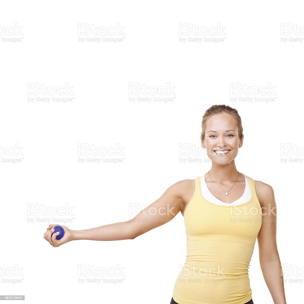 Working her muscles with a stress ball stock photo