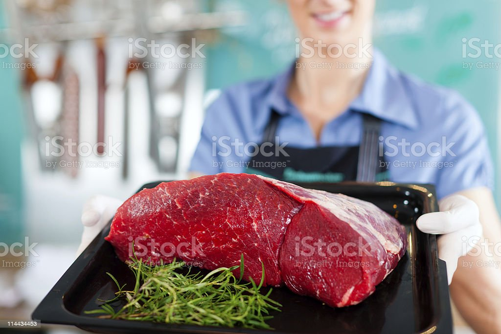 Working in a butcher's shop stock photo