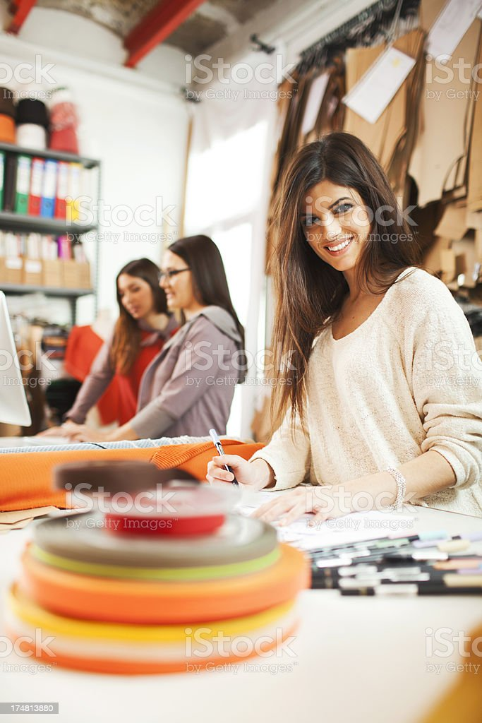 Working in a clothes design studio. stock photo
