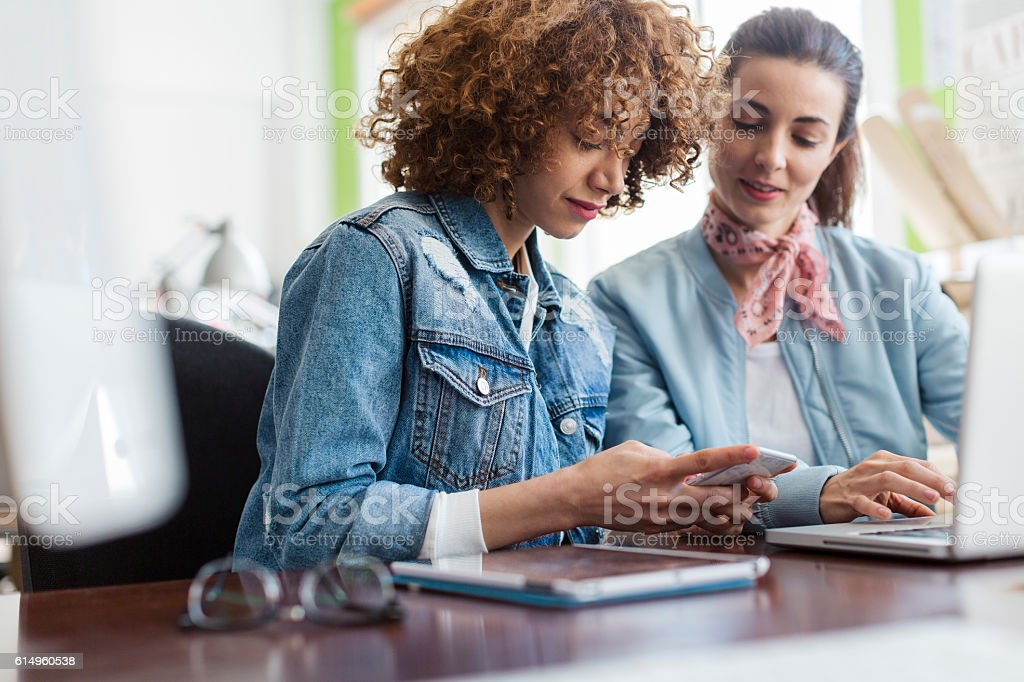 Working in a creative small business office stock photo