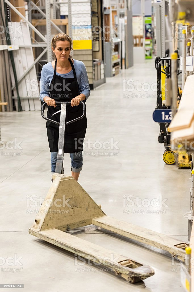 Working in a hardware store warehouse stock photo