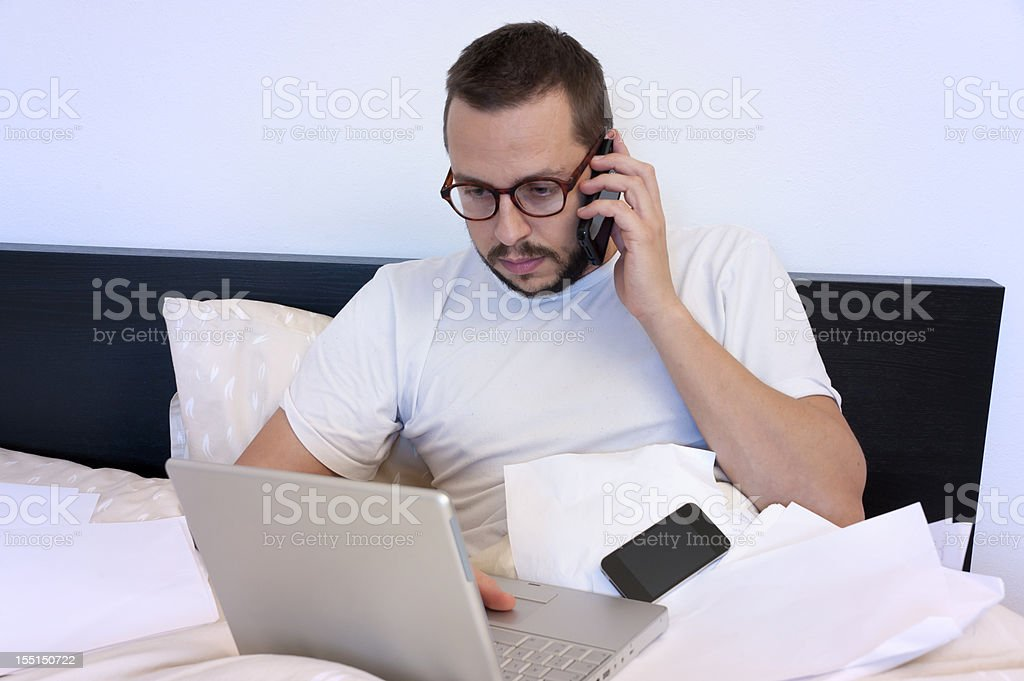 Working in bed royalty-free stock photo