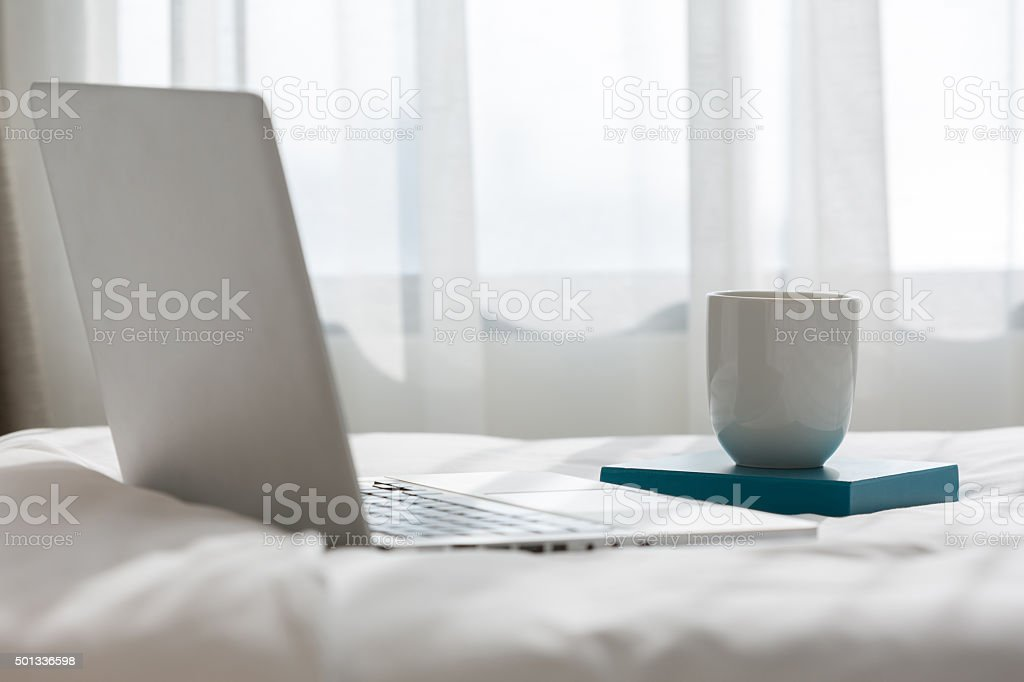 Working in bed stock photo