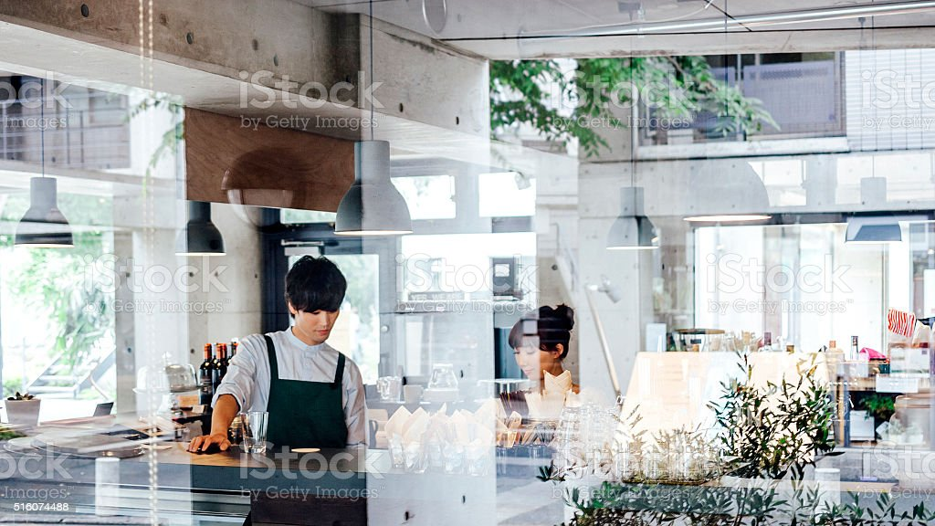 Working in cafe, Japan. stock photo