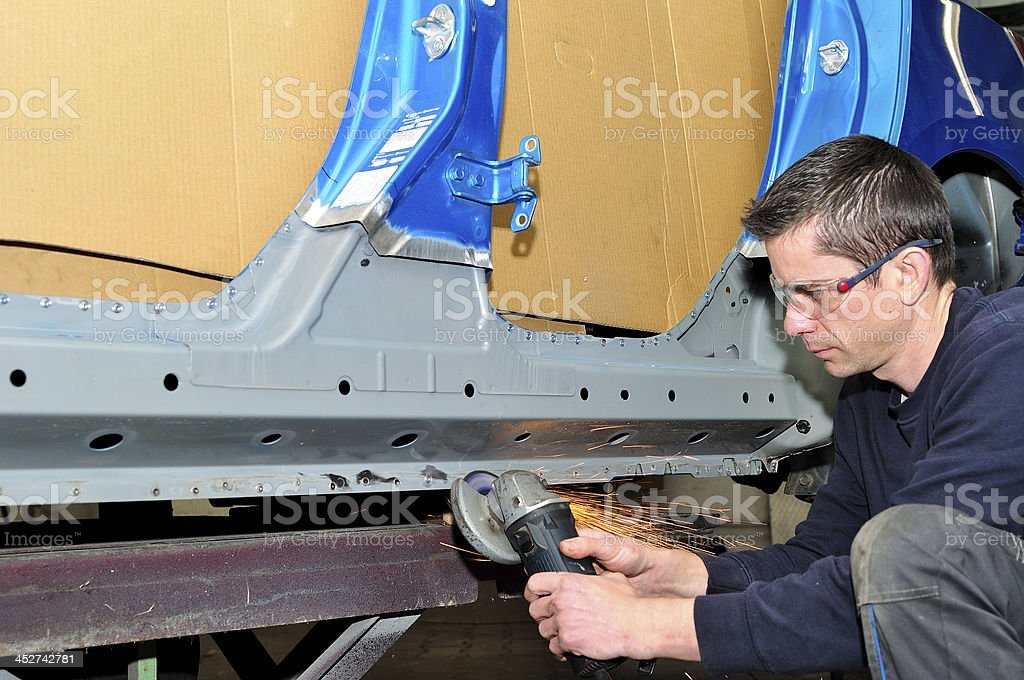Working in car body shop. stock photo