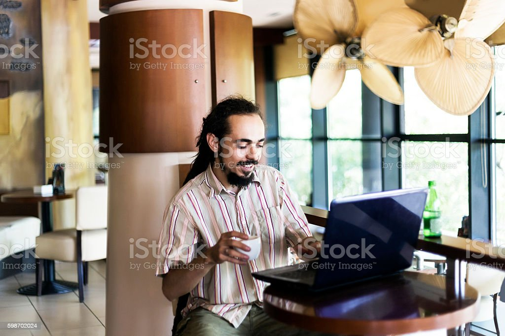 Working in coffee shop stock photo