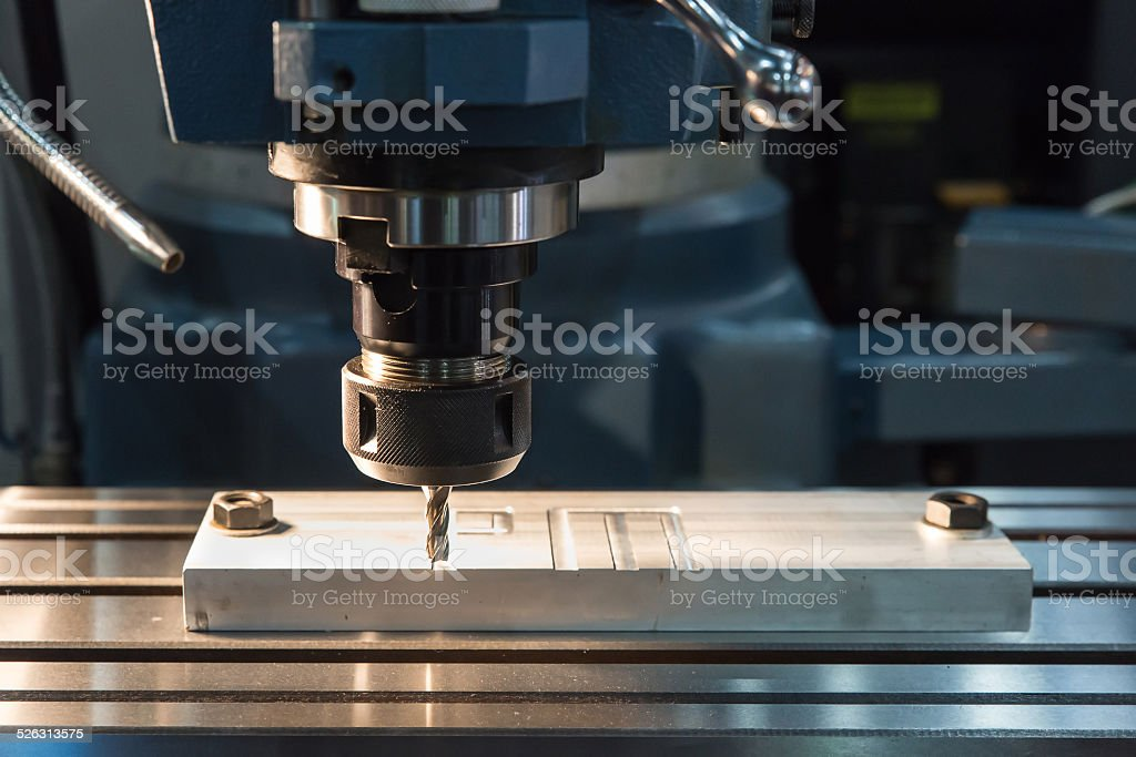 CNC ENGRAVER working in factory stock photo