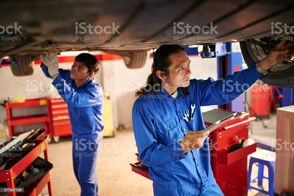 Working in garage stock photo